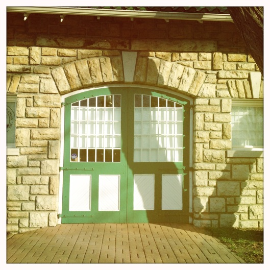 green carriage house doors