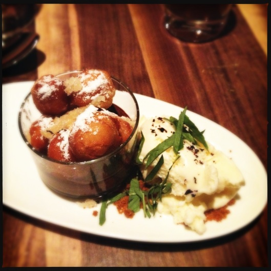 Doughnut holes with condensed milk ice cream, basil and chocolate mousse/ A delightful finish.