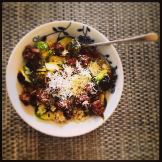 Dinner of Mint Creek Farm's lamb sausage and Roasted brussel sprouts over Quinoa with a dusting of parmesan. So good.