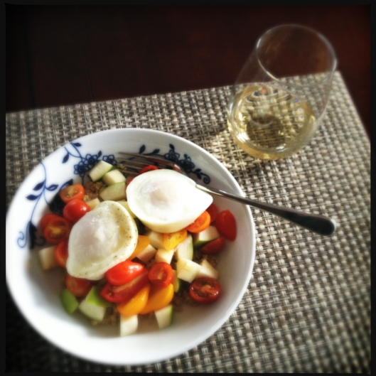 Poached eggs over quinoa, green apples and grape tomato's with a side of white wine is a delightful dinner option
