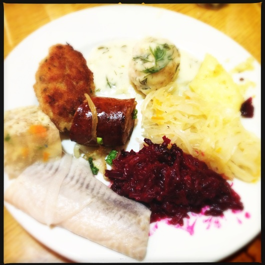 Schnitzel, Dill gravy meatballs, Fried Sauerkraut, Fried Beets, Herring in vinegar, Chicken Aspic and Polish Sausage (also a cheese dumpling which is hiding from the camera)